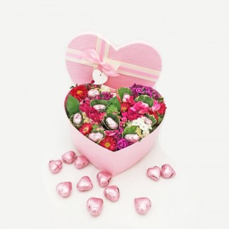 Garden of flowers and heart shaped Chocolate